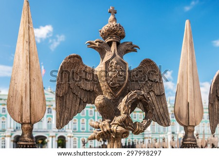 Double-headed eagle in the imperial crown on the fence of the Alexander Column in St. Petersburg (focus at the eagle) - stock photo