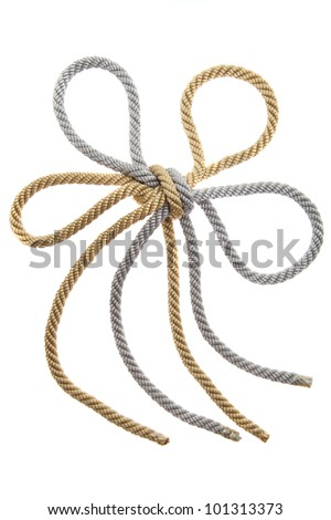 Double Knot on a gold and silver rope isolated, flower - stock photo