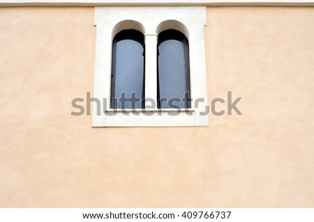 double lancet window on the facade of the church of San Filippo Neri in Fara in Sabina. It is assumed that in 1685 the church was built or under construction. - stock photo
