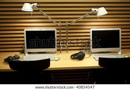 Double office desk with computer and reading lamp - stock photo