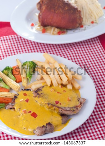 double pork in mustard source and pork leg - stock photo