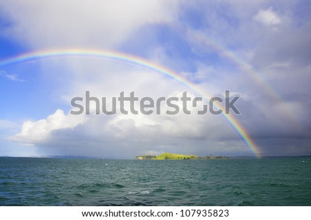 Double rainbow off the shore of Auckland, New Zealand - stock photo