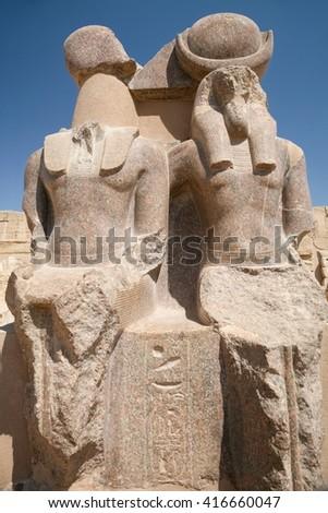 double sculpture, or two statues of landmark Egyptian goddess Sekhmet, monument in Temple of Medinet Habu or Ramses III, in Luxor, Egypt, Africa - stock photo