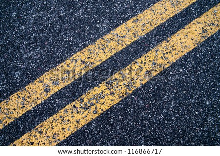 Double strip traffic lines on the road to the top of crater lake national park, oregon, usa, america - stock photo
