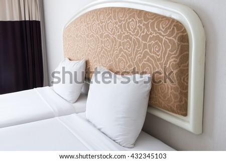 Double white pillow on the large bed of the luxury bedroom. - stock photo