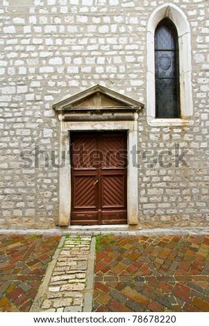 Double wooden door entrance to Catholic church - stock photo