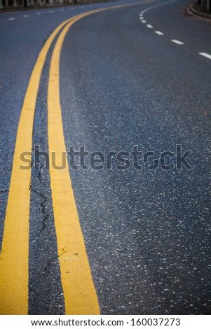 double yellow line in the asphalt road - stock photo