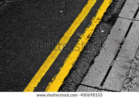 Double yellow lines - stock photo