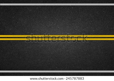Double yellow lines on asphalt road - stock photo