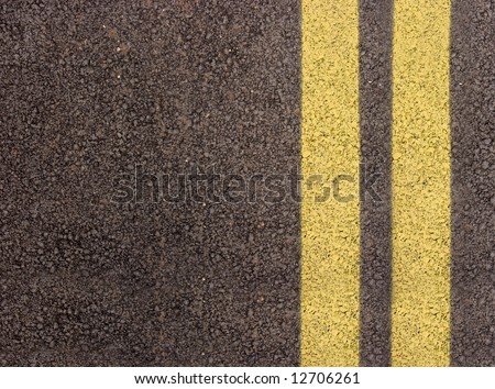 Double yellow lines on the edge of a lane - stock photo