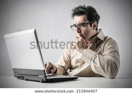 doubtful businessman weighing pros and cons - stock photo