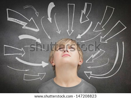 Doubtful child looking up - stock photo