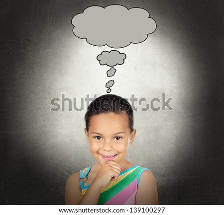 Doubtful little girl with a bubble on a over gray background - stock photo