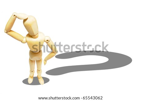 Doubtful wooden dummy with question mark shadow - stock photo