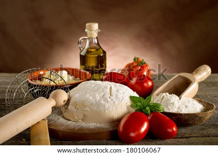 dough and ingredients for homemade pizza - stock photo