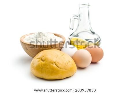 dough and ingredients for preparing pasta on white background - stock photo