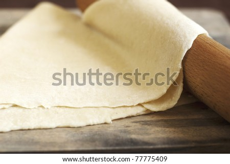 dough and rolling pin - stock photo