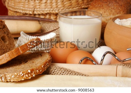 Dough for baking and a cup of yogurt - stock photo