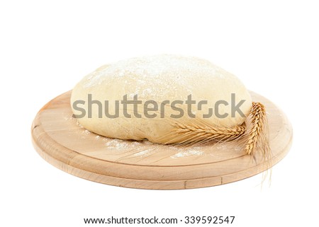 Dough for bread and wheat ears isolated on white background. - stock photo