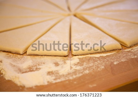 dough for the preparation of croissants - stock photo