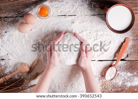 dough in the hands of - stock photo