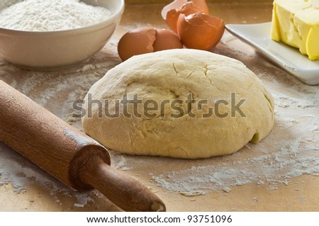 Dough on wooden board. - stock photo