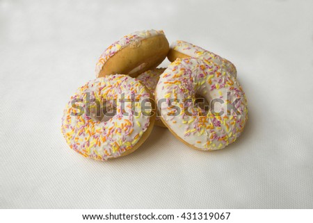 Doughnut for tea. Donuts stacked slide. Tasty food cakes. Delicious classic cakes: fried doughnuts glazed with caramel. Nutritious dish that promotes obesity. - stock photo