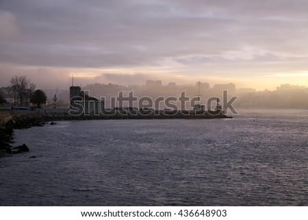 Douro River, near its mouth, tide gauge area, in a colorful sunrise - stock photo