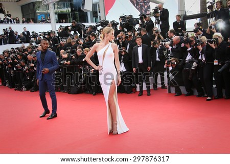 Doutzen Kroes,  husband Sunnery James attend the opening ceremony and 'La Tete Haute' premiere during the 68th annual Cannes Film Festival on May 13, 2015 in Cannes, France. - stock photo