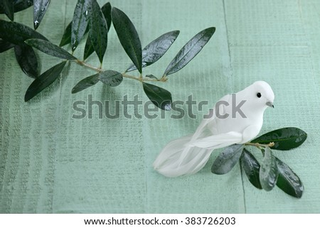 dove of peace on green table - stock photo