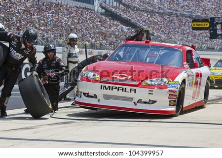 DOVER, DE - JUN 03:  Kurt Busch (51) brings his Phoenix Chevrolet in for service during the FedEx 400 Benefiting Autism Speaks at the Dover International Speedway in Dover, DE on Jun 03, 2012. - stock photo