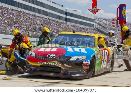 DOVER, DE - JUN 03:  Kyle Busch (18) brings in his MMs Toyota for service during the FedEx 400 Benefiting Autism Speaks at the Dover International Speedway in Dover, DE. - stock photo