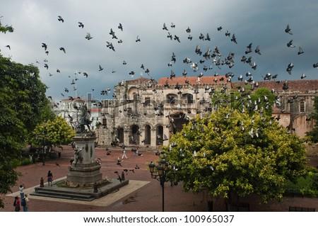 Doves flying over the main square in Santo Domingo, Dominican Republic - stock photo