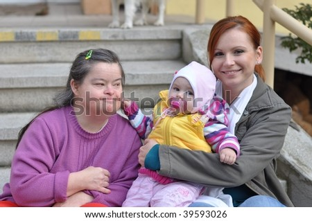 down syndrome woman with baby - stock photo