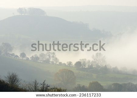 Downham Hill in Fog Viewed from  Coaley Peak, near Dursley, Gloucestershire - stock photo