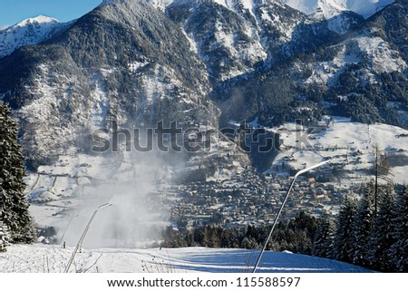 downhill ski slope at sunny winter day in the mountains - stock photo