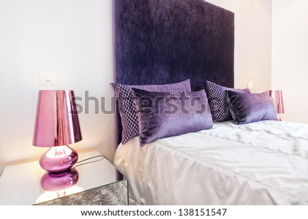 Downlights lamps in the bedroom beside the bed. - stock photo