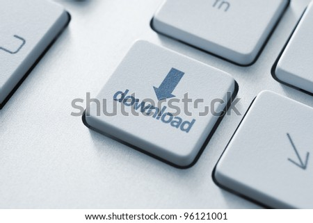Download key on the keyboard. Toned Image. - stock photo