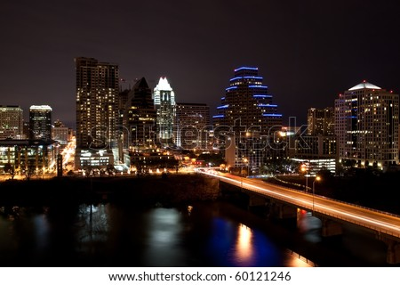 Downtown Austin Texas Cityscape at night from across Lady Bird Lake formally known as Town Lake - stock photo