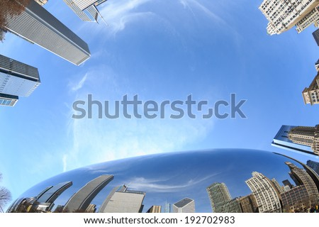 Downtown buildings reflected in the mirror surface of The Bean sculpture in Millennium Park in Chicago, Illinois. - stock photo