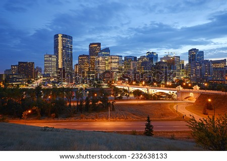downtown calgary in an evening after sunset - stock photo