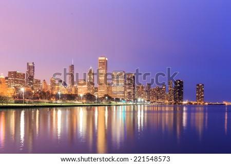 Downtown Chicago across Lake Michigan at sunset, IL, USA - stock photo