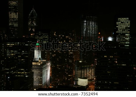 Downtown Chicago at Night with the Wrigley Building Clock Tower in Holiday Colors - stock photo