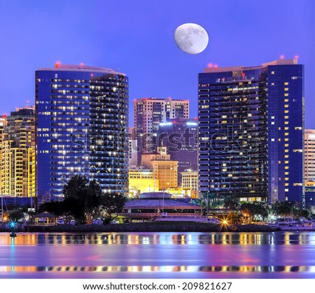 Downtown Cityscape with Buildings Reflecting, City of San Diego, California USA and Moon  - stock photo