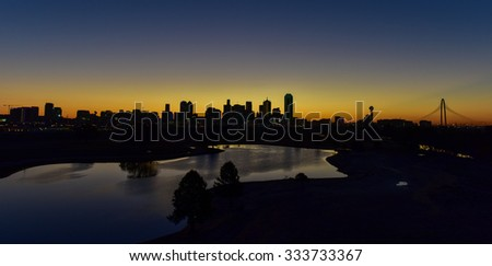 Downtown Dallas skyline at sunrise in Texas, USA from the Trinity River. - stock photo