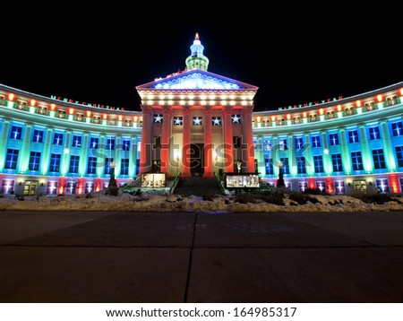 Downtown Denver at Christmas. Denver's City and County building decorated with holiday lights. - stock photo