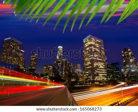 Downtown LA night Los Angeles sunset skyline California from 110 freeway - stock photo