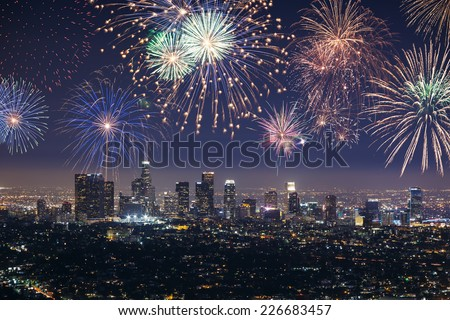 Downtown Los angeles cityscape with flashing fireworks celebrating New Year's Eve. - stock photo