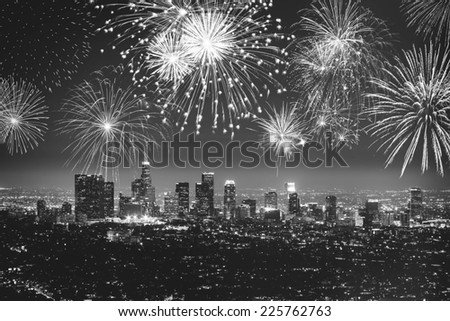 Downtown Los angeles cityscape with flashing fireworks celebrating New Year's Eve in black and white. - stock photo