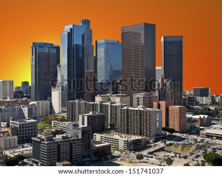 Downtown Los Angeles with orange sunset sky.   - stock photo